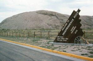 entrance sign identifying large stone formation known as Independence Rock, Wyoming