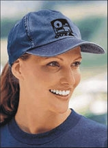 smiling woman wearing baseball cap with OCTA logo