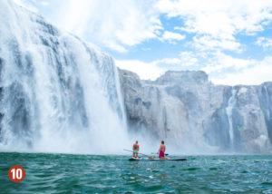 Wake boarders looking at waterfall